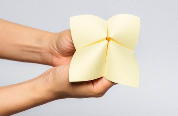 Hand holding yellow chatterbox