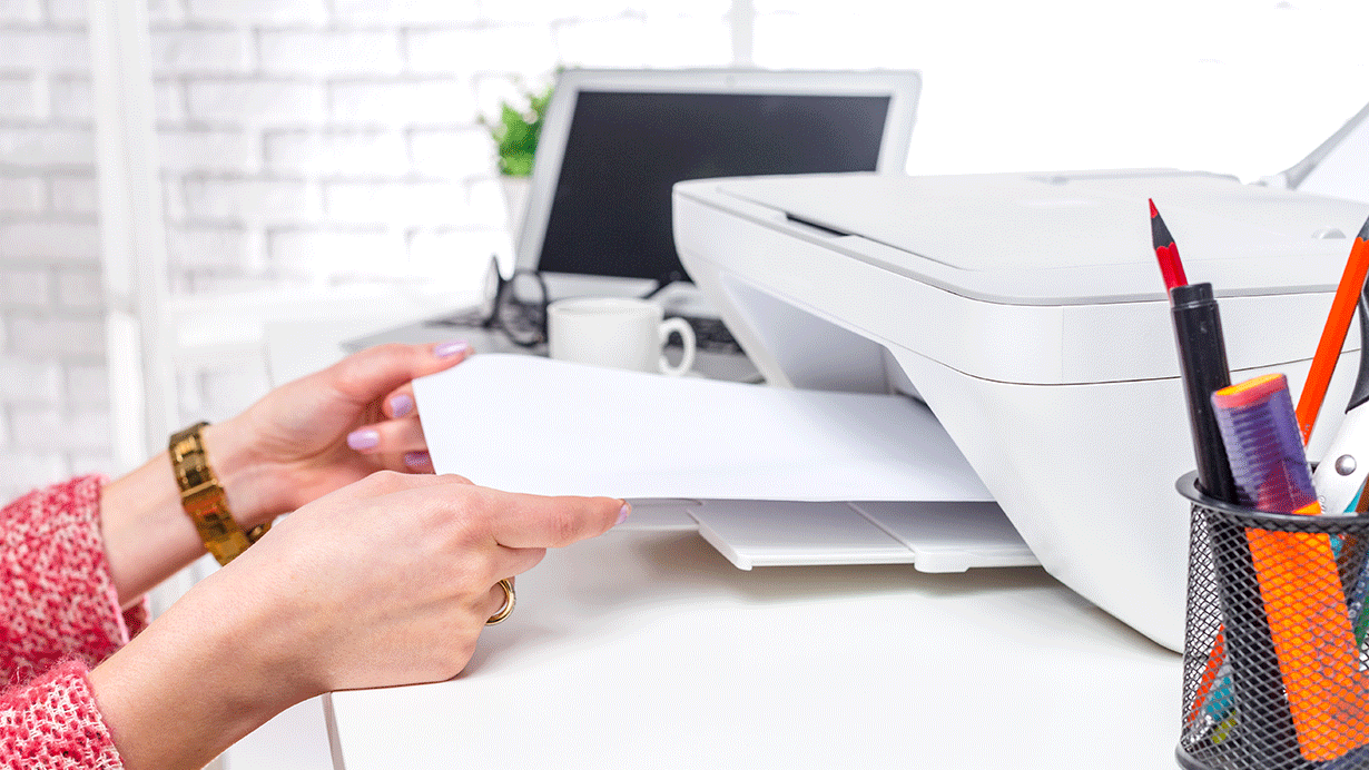 Woman taking print out from printer